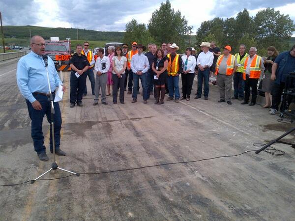 Transportation Minister Ric McIver joins local officials and residents for the opening of the Sheep River Bridge on Highway 22.